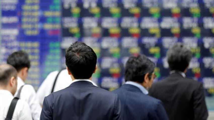 Asia stocks advance toward historic highs, US earnings test