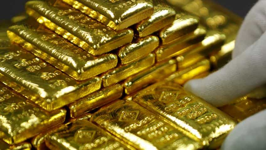 Gold hits over four-month high as dollar index slumps to three-year lows