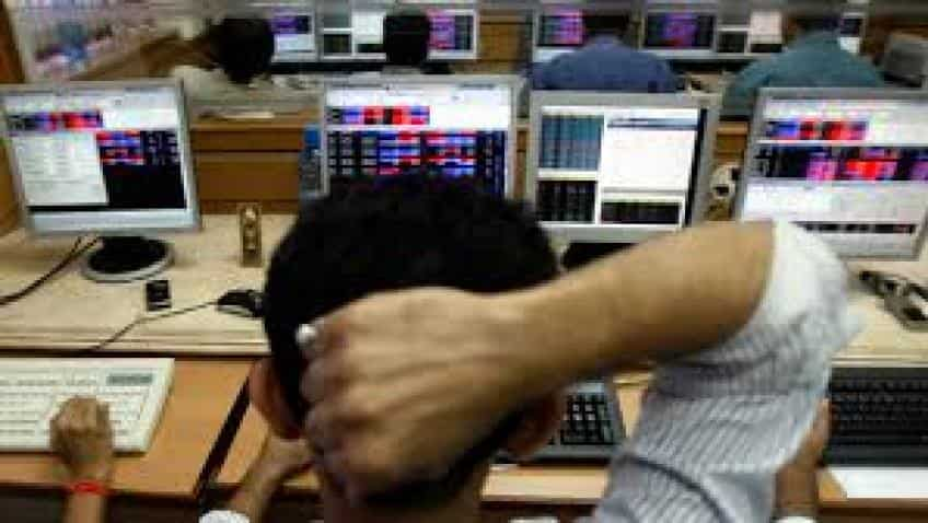 Sensex trades flat, Nifty slips below 10,700; IT stocks lead