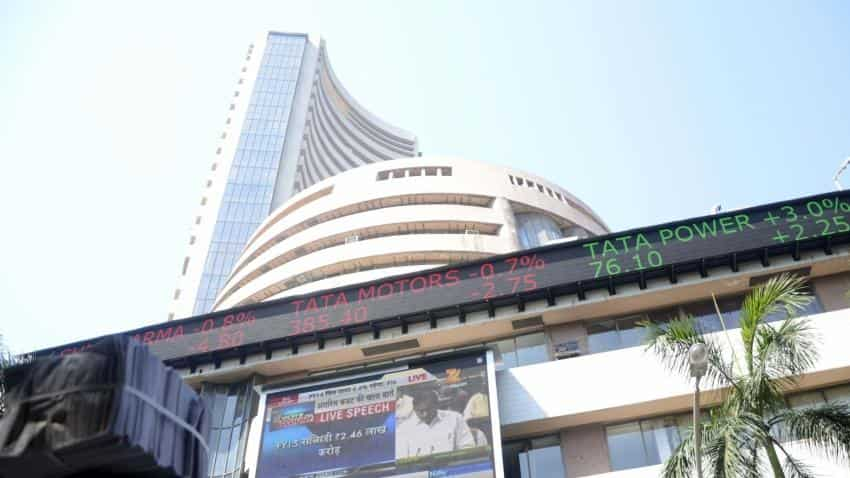 Sensex trades flat, Nifty holds above 10,800; YES Bank top gainer
