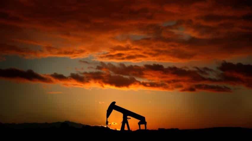 Oil falls below $69 as stronger dollar dents risk assets