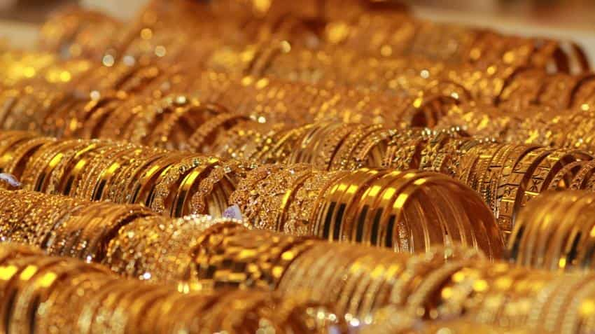 Yellow metal price tumbles in India; Spot gold edges up