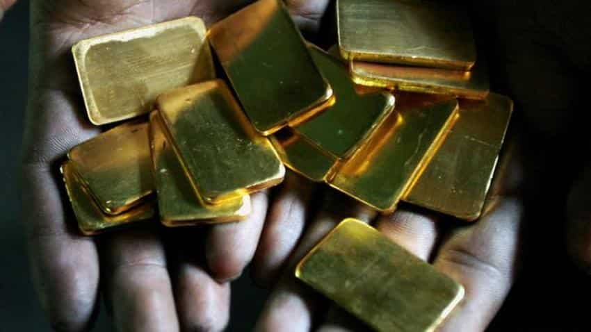 Gold rises on weaker US dollar ahead of US inflation data