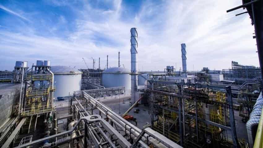 Oil stable on weak dollar, economic growth, but pockets of oversupply linger