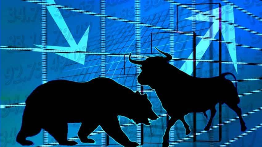 Sensex turns flat, Nifty trades below 10,400; PSU banks drag