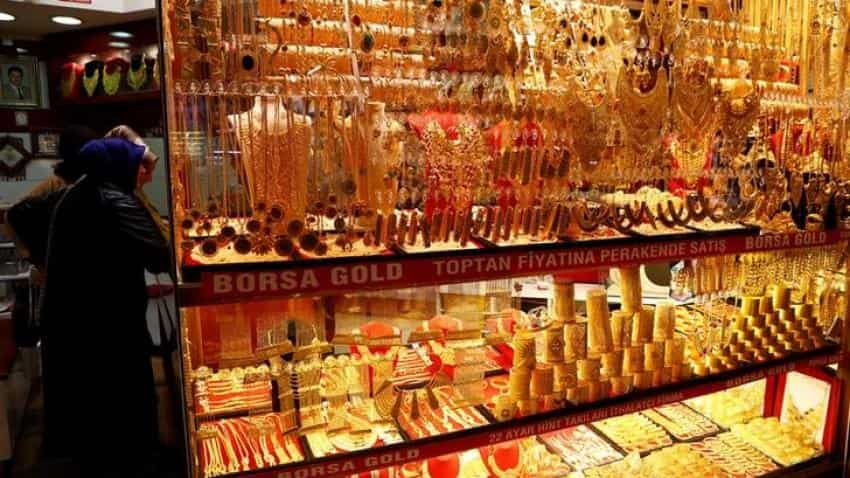 Gold slips marginally to Rs 30,433; track city-wise prices here
