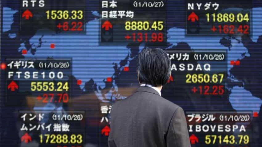 Asian markets slip after Donald Trump adviser's departure heightens trade war fears