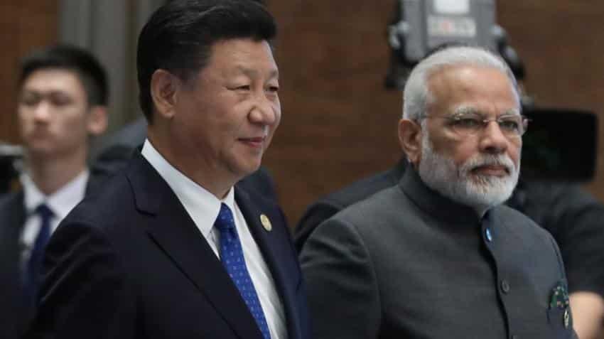 Narendra Modi, Xi Jinping talk; pledge more cooperation