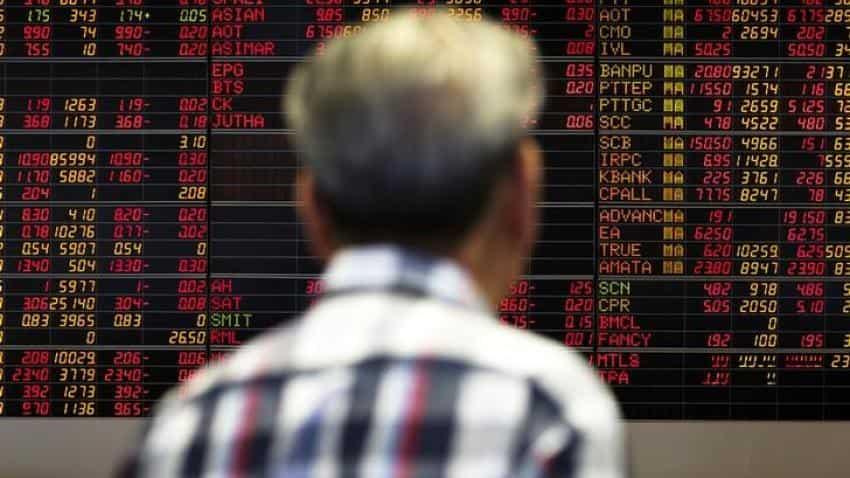Asia marketss lag Wall Street amid dollar strength