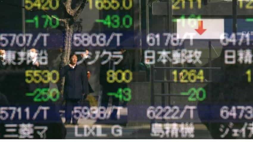 Asian markets tentative as Donald Trump tempers Sino-US trade optimism