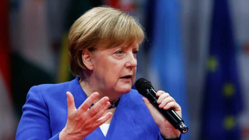 German Chancellor Angela Merkel  tells Italy: euro zone rules must frame economic discussions