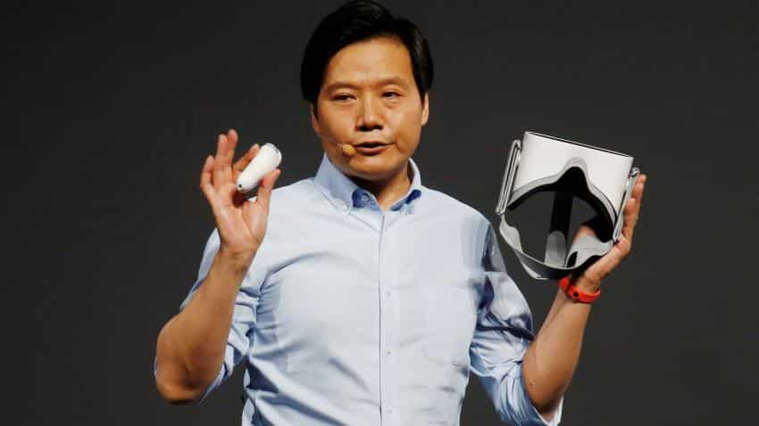 Xiaomi, bound for IPO, woos fans, investors at glitzy launch