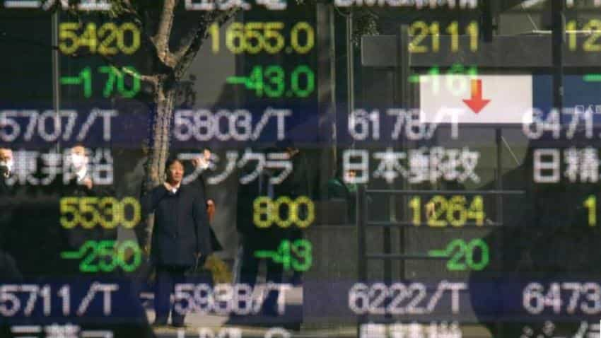 Asian markets step back as investors brace for US Fed outcome