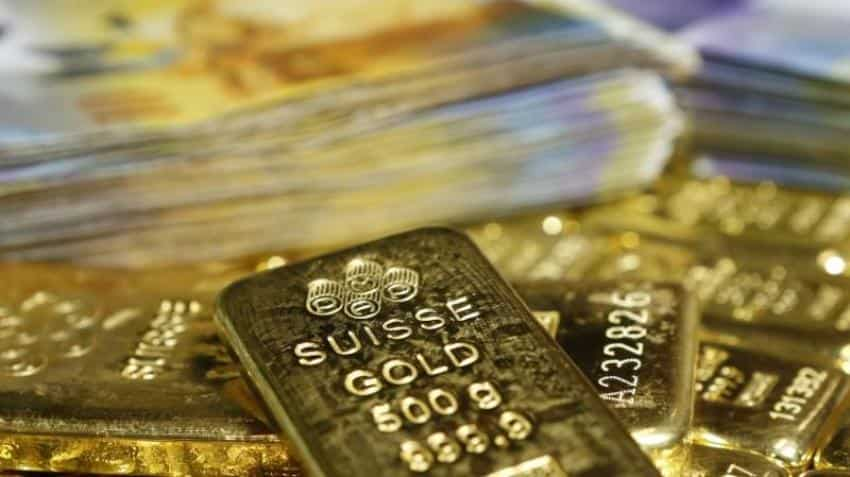 Gold slips on stronger dollar; U.S.-China trade war fears loom