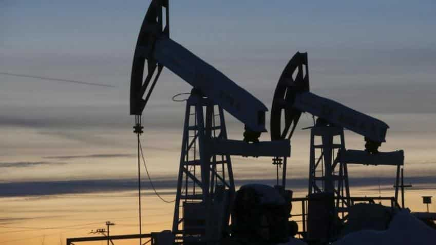 Oil falls as flaring US-China trade dispute blunts risk appetite