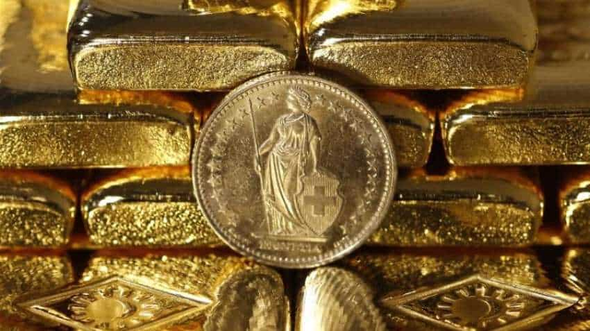 Gold prices recover from 6-month low as dollar drops; Russia buys bullion