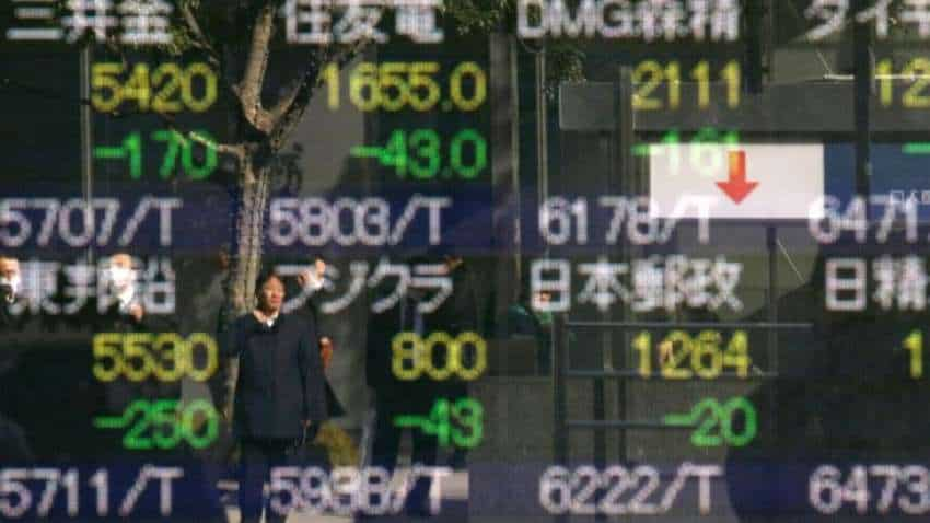 Asian markets sluggish ahead of major economic events, Mexico peso up on exit polls