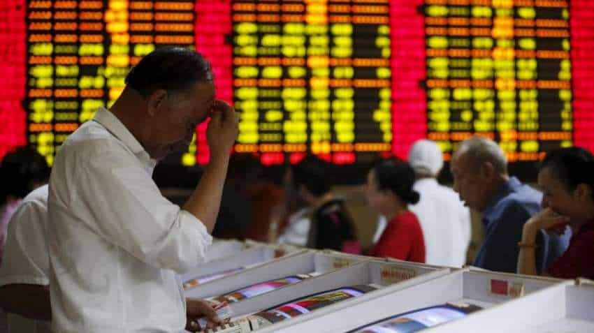 China seeks to soothe markets as trade angst rattles stocks, yuan