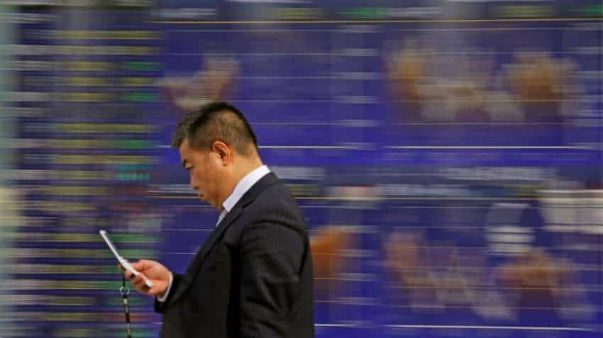 Asian shares, yuan on shaky ground on specter of Sino-US trade war