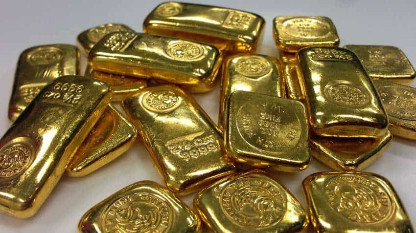 Gold trims losses on soft dollar after US tariffs take effect