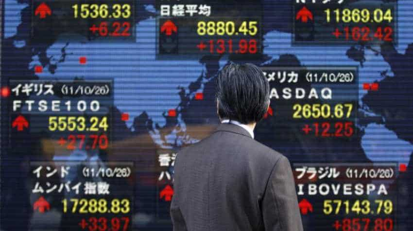 Asian markets sag on trade war fears, dollar buoyant
