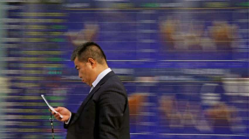 Asian markets sag after oil prices slide, dollar steady before US Fed speech