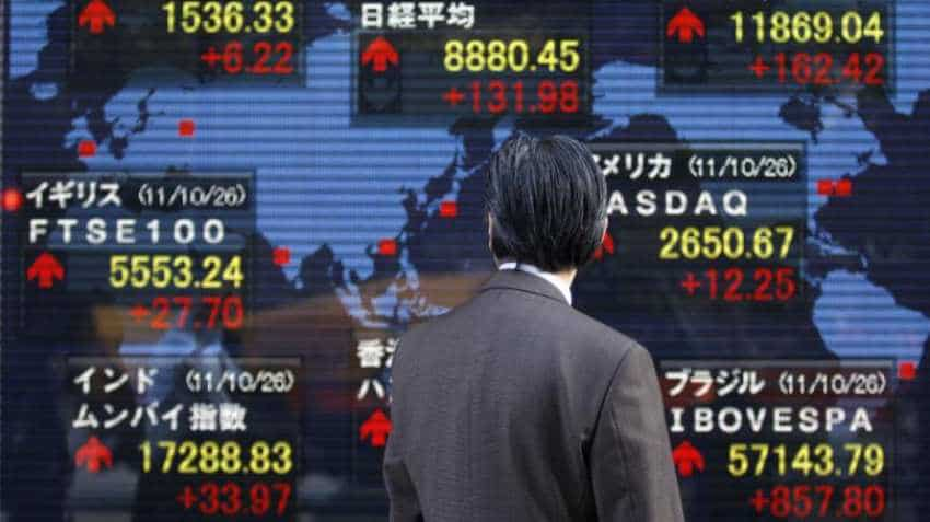 Asian markets ease, dollar near two-week lows on Donald Trump comments