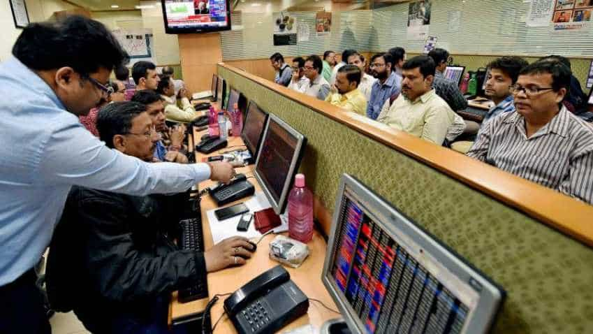 Sensex hits record high, trades flat in noon deals; ICICI Bank, SBI top gainers