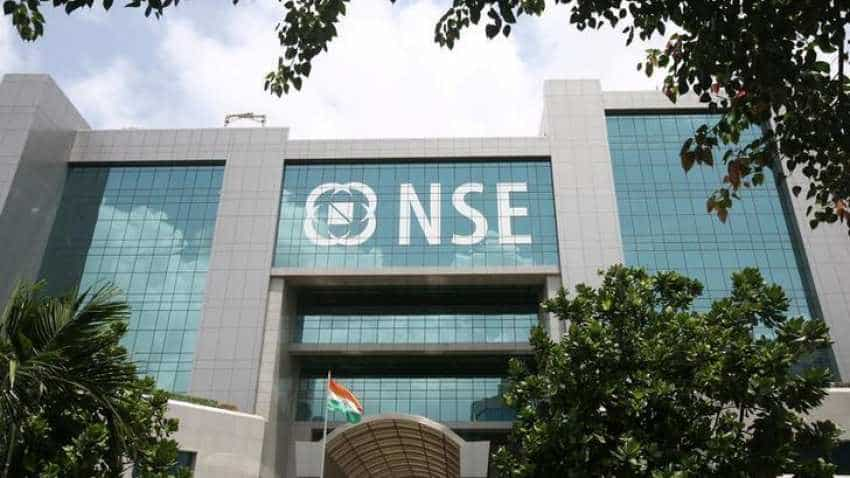 Sensex eases from record highs; financials drag