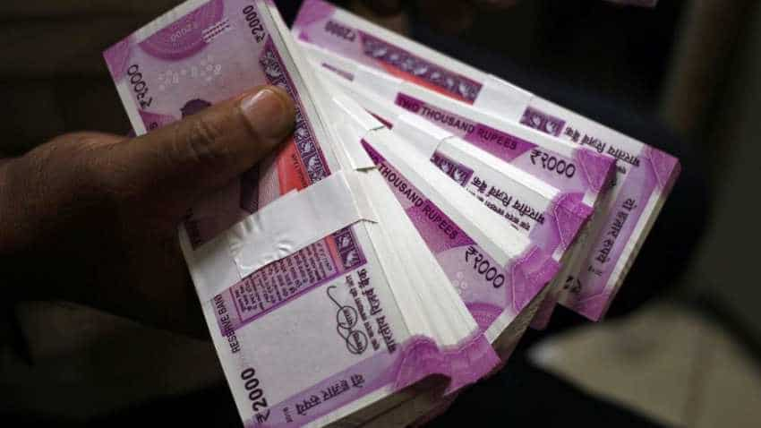 Rupee to trade near record low over coming year; trade anxiety weighs: Reuters poll