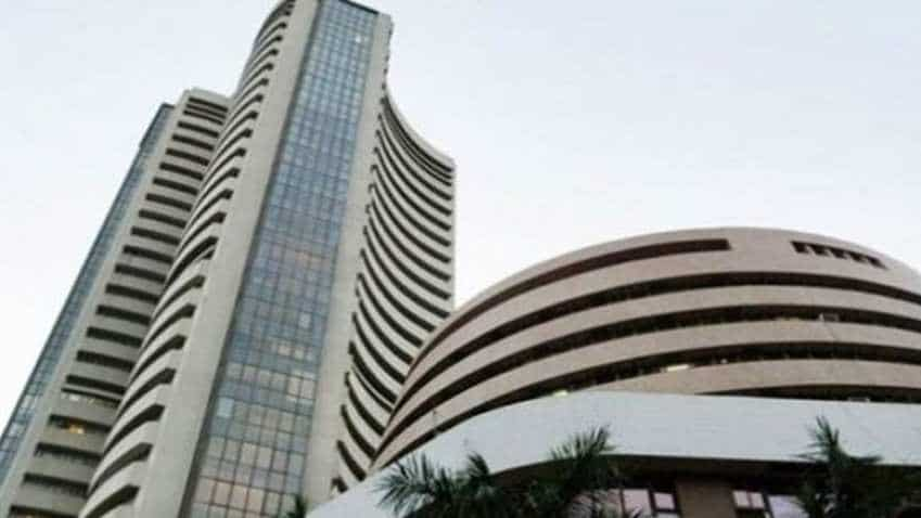 Market Review: Easing inflation, global cues lift equity indices; weak rupee limits gains