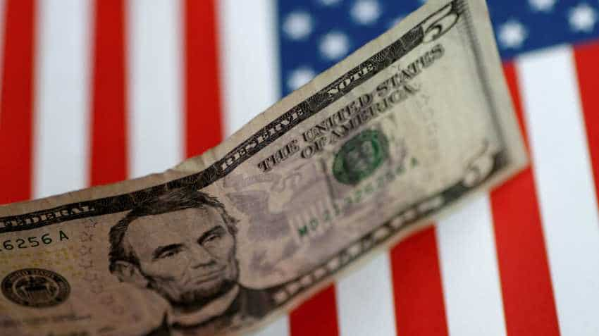 Strong U.S. economy buoys dollar, puts Asian currencies on skids: Reuters poll