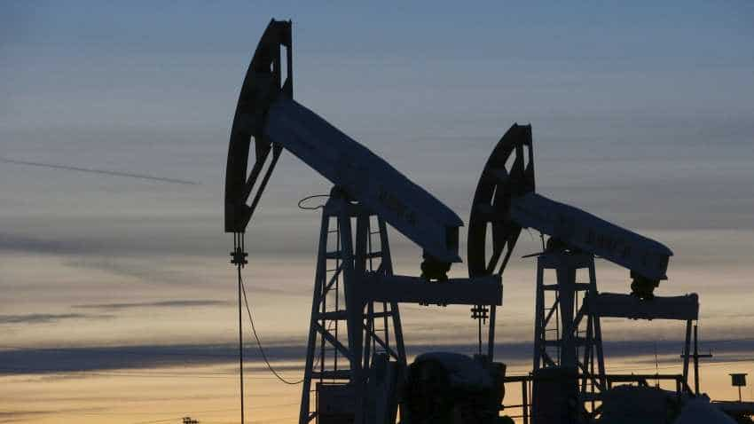 Oil rises as China reports record crude imports, but soaring US output caps gains