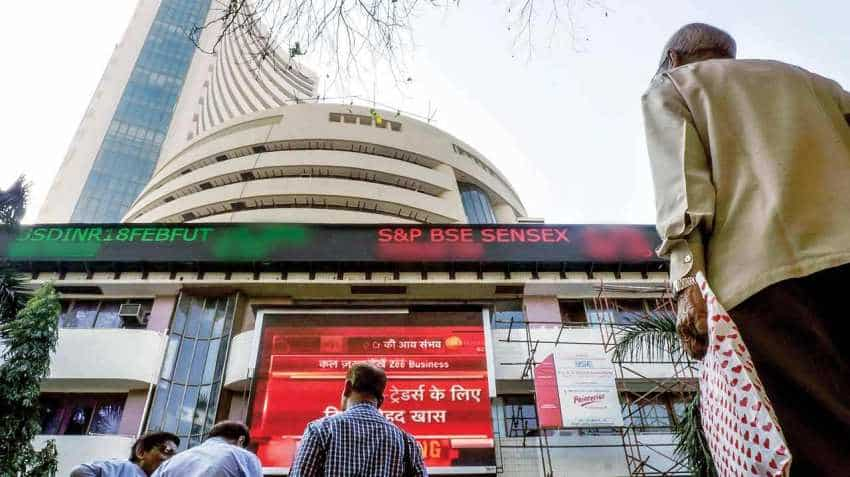Sensex surges over 200 pts, Nifty reclaims 10,700 mark ahead of F&O expiry