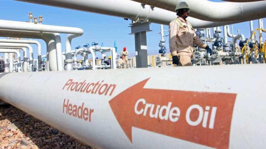 Oil prices slide on swelling US supply, global market slump