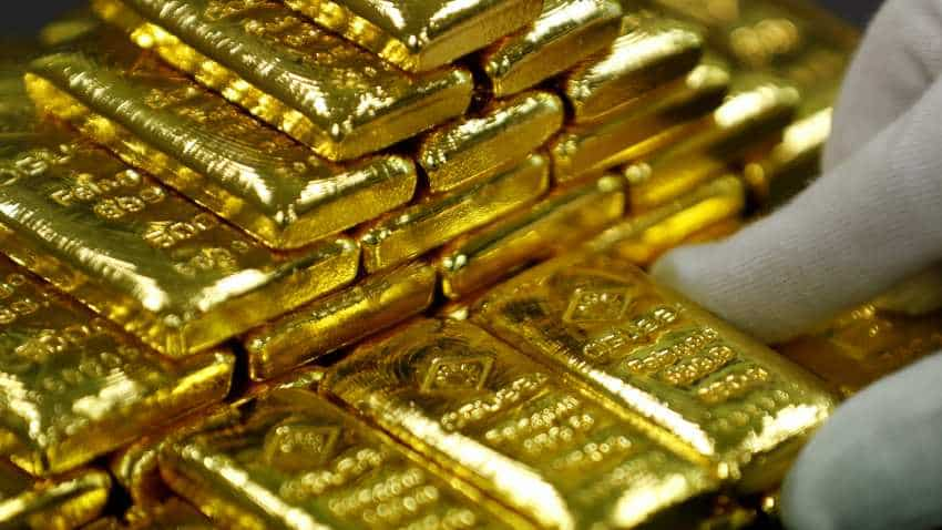 Gold rises, holds near six-month highs on volatile shares