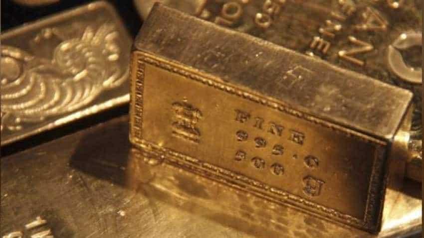 Gold shines on weak dollar, Fed chief's dovish tone on rate hike