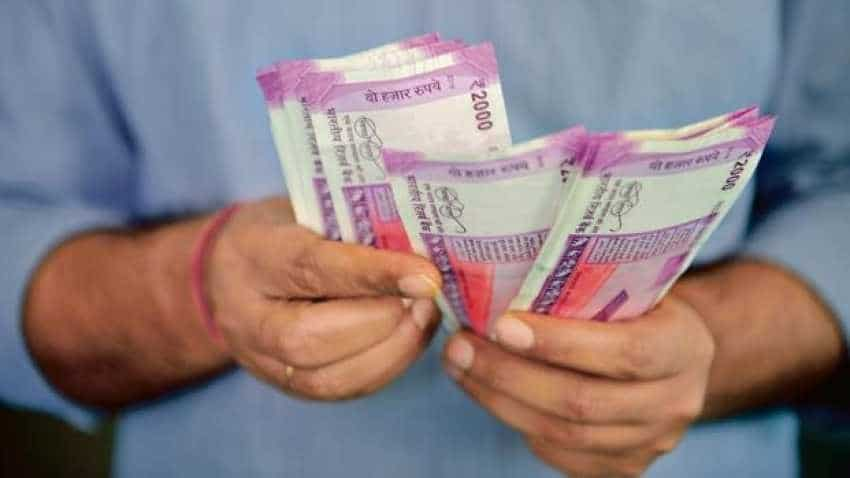 Rupee up by 9 paise against dollar in early trade