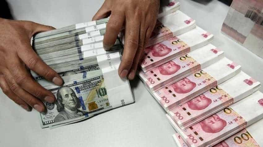 China's yuan edges lower against US dollar