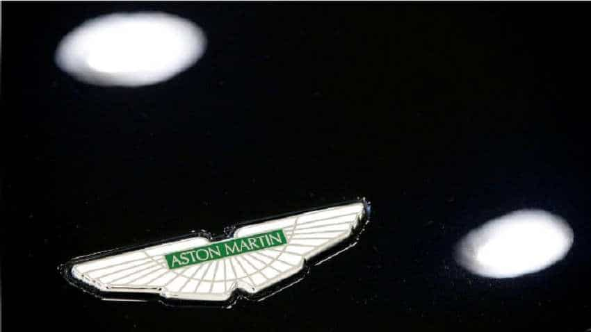 Luxury British carmaker Aston Martin's adjusted pre-tax profit falls