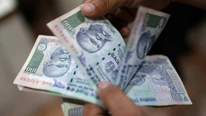Rupee slips 14 paise against US dollar in early trade