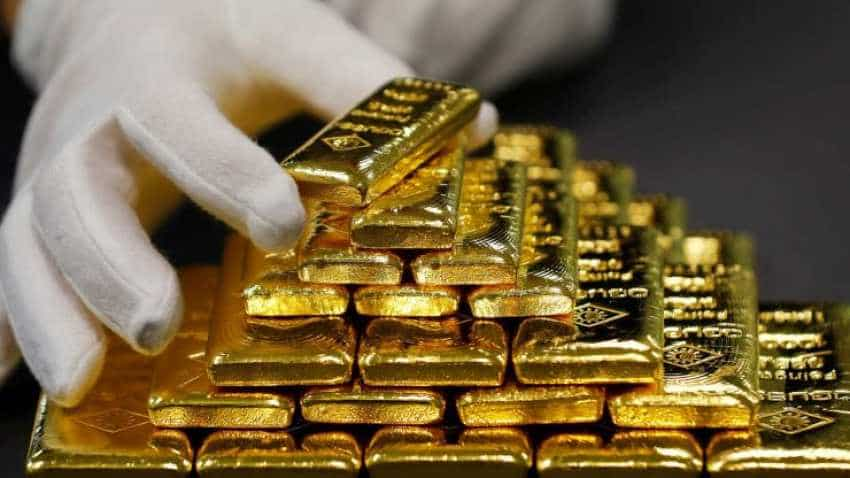 Gold prices fall on dollar, stocks; on track for worst week since May 2017