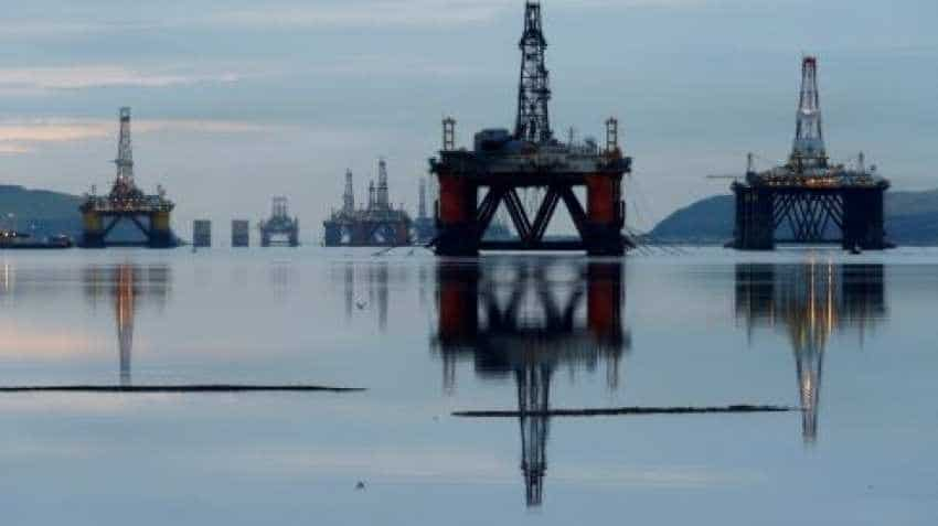 Oil slips but holds near 2019 peak as supplies tighten
