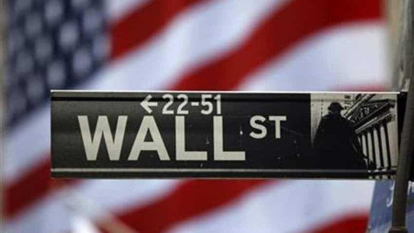 Wall Street rally takes a pause; Walgreens bleeds 12.8%, Facebook lifts Nasdaq