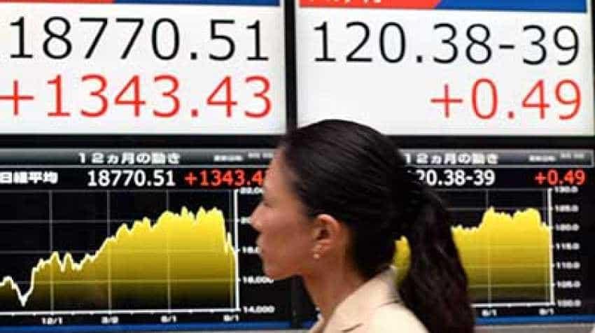 Asian stocks trade tepid on global economic slowdown worries, rise in dollar index