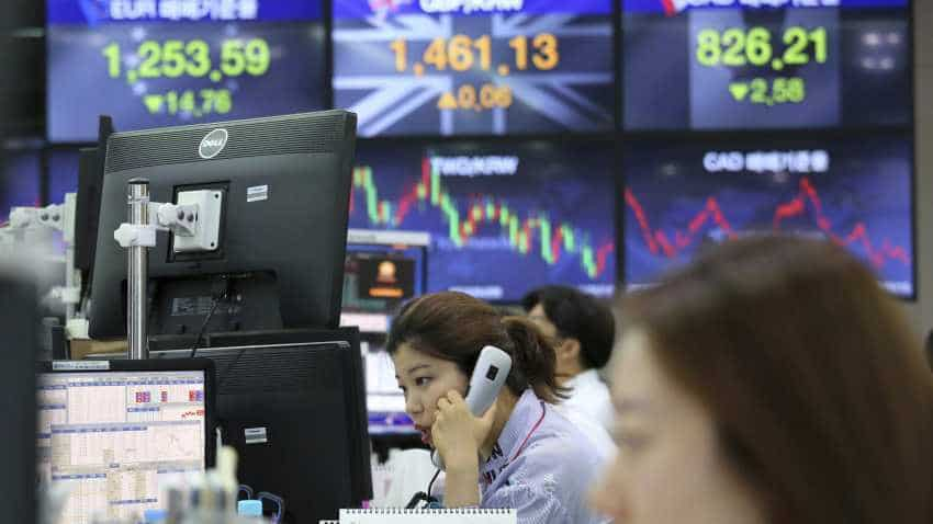 Asia stocks hover below nine-month peak after Wall Street stalls