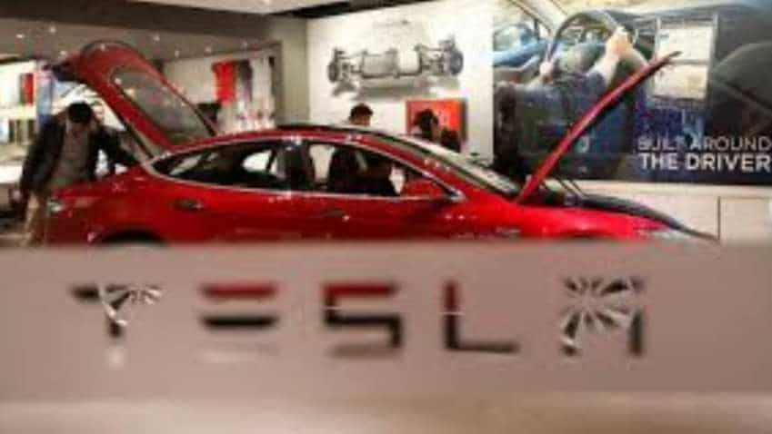 Elon Musk-led Tesla says may seek new funding; shares up after SEC agreement