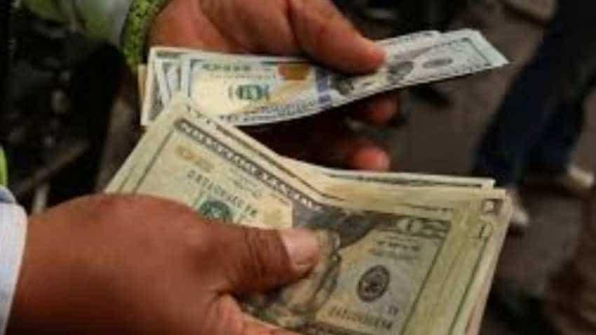 Dollar edges down amid CPI data