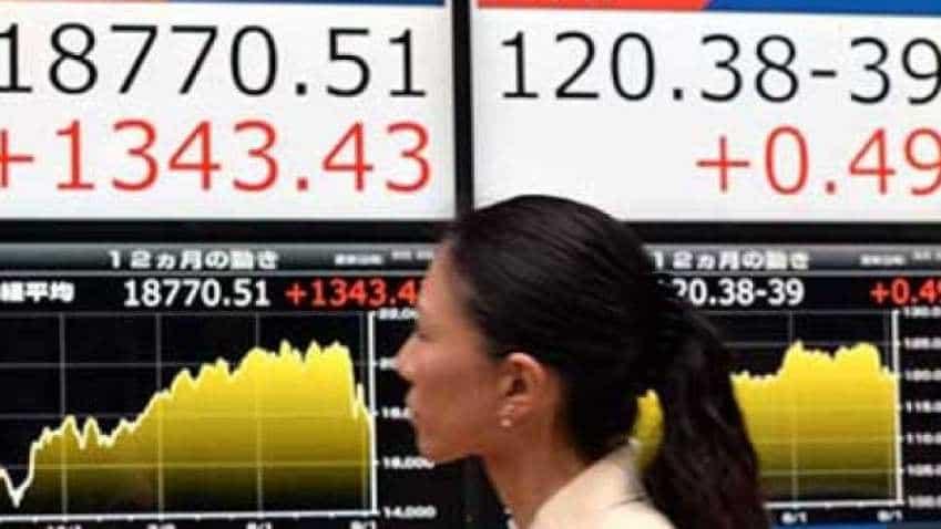 Asia stocks sag, bonds rally as trade war fears persist