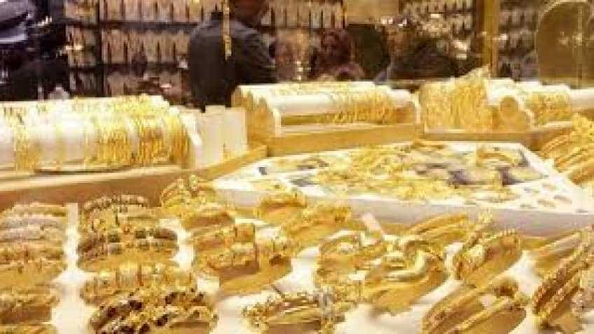 Gold prices dip as robust US economic data dampens Fed rate cut expectations